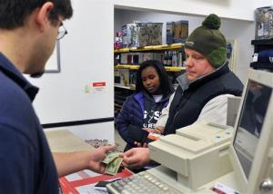 In this Dec. 12, 2011, photo, Jeremy Lucas and Latasha Lucas pay off the rest of their layaway at the Kmart in Grand Rapids, Mich.