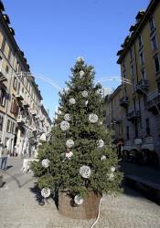 A Christmas tree the was previously adorned with red sex toys is displayed in a street, in Milan, Italy, Friday, Dec. 13, 2013.
