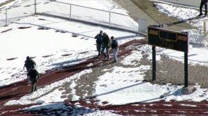 In this still image taken from video provided by Fox 31 Denver, police respond to reports of a shooting at Arapahoe High School in Centennial, Colo.