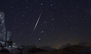 In this 2009 photo provided by Wally Pacholka of AstroPics.com, a Geminid fireball explodes over the Mojave Desert in California.