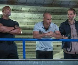 This film publicity image released by Universal Pictures shows Dwayne Johnson , left, Vin Diesel, center, and Paul Walker in a scene from Fast & Furious 6.