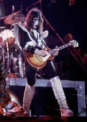 Paul Ace Frehley, lead guitarist for the hard-rock glam band KISS, performs with a Gibson Les Paul guitar during a concert at the Civic Center in Harford, Conn., in this Feb. 16, 1977 file photo.