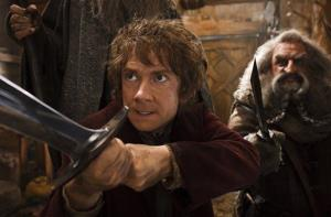 This image released by Warner Bros. Pictures shows Martin Freeman, left, and John Callen in a scene from The Hobbit: The Desolation of Smaug.  Harvey and Bob Weinstein have sued Warner Bros.'