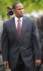 In this May 20, 2008 file photo, R&B musician R. Kelly arrives to court in Chicago for the first day of opening arguments for his child pornography trial.