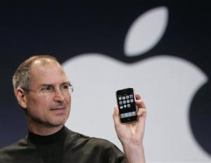 Apple CEO Steve Jobs holds up an Apple iPhone at the MacWorld Conference in San Francisco, Jan. 9, 2007.