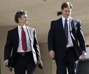 Kurt Mix, left, leaves Federal Court with an unidentified member of his defense team in New Orleans, Wednesday, Dec. 18, 2013, after he was convicted of one charge.