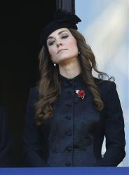 Britain's Duchess of Cambridge Kate Middleton listens from a balcony during the service of remembrance at the Cenotaph in Whitehall, London, Sunday, Nov. 10, 2013.