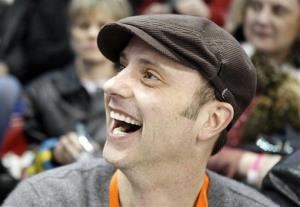 Former Olympian Brian Boitano smiles in the stands during the men's singles competition at the US figure skating championships in Spokane, Wash., Friday, Jan. 15, 2010.