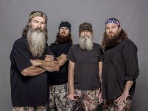 This 2012 photo released by A&E shows, from left, Phil Robertson, Jase Robertson, Si Robertson and Willie Robertson from the A&E series, Duck Dynasty.