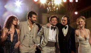 From left, Amy Adams, Bradley Cooper, Jeremy Renner, Christian Bale, and Jennifer Lawrence in a scene from American Hustle.