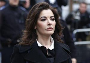 In this Wednesday, Dec. 4, 2013 file photo, celebrity chef Nigella Lawson arrives at Isleworth Crown Court in London.