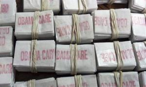 This photo released by the Massachusetts State Police via Facebook shows some of the 1,250 packets of heroin labeled Obamacare and Kurt Cobain.