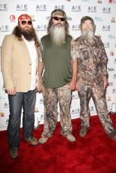 In this May 9, 2012 photo, Willie Robertson, left, Phil Robertson, center, and Si Robertson pose at the A&E Networks 2012 Upfront at Lincoln Center in New York.