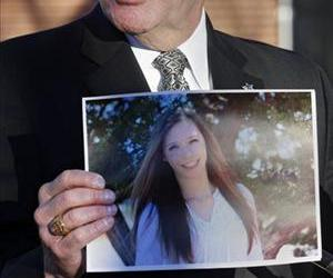 Arapahoe County Sheriff Grayson Robinson holds a picture of Claire Davis the 17-year-old student that was shot.
