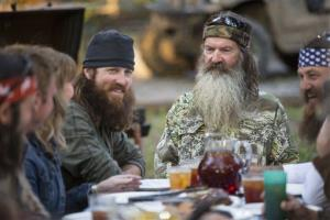 This undated image released by A&E shows Phil Robertson, flanked by his sons Jase Robertson, left, and Willie Robertson from the popular series Duck Dynasty.