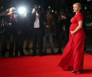 British actress Kate Winslet, arrives on the red carpet for the gala screening of the film Labor Day, as part of the 57th BFI London Film Festival, at a central London cinema, Monday, Oct. 14, 2013.