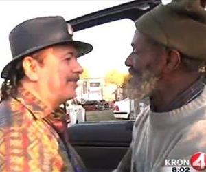 In this Friday, Dec. 20, 2013 frame grab from video provided by KRON-TV, famed rock guitarist Carlos Santana, left, greets his former bandmate Marcus Malone.