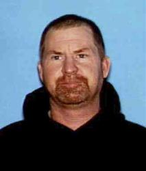 This undated photo released by the Shasta County Sheriff's office shows Shane Miller, 45.