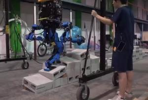 The Schaft robot, by a Japanese firm purchased by Google, won the competition.