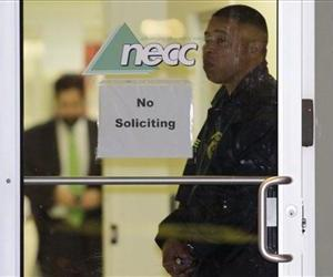 In this Oct. 16, 2012 file photo, a Food and Drug Administration Agent stands at the doorway of New England Compounding Center in Framingham, Mass.,  as investigators work inside.