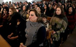 Iraqi Christians attend a Christmas mass at the Mother Teresa Catholic Church in Basra, Iraq, Wednesday, Dec 25, 2013. Militants launched two separate attacks against Christians in Baghdad.