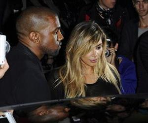 In this Sept. 29, 2013, photo, Kanye West and Kim Kardashian leave after attending Givenchy's ready-to-wear Spring/Summer 2014 fashion collection in Paris.