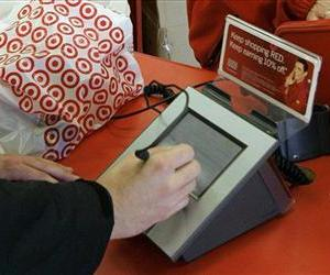 In this 2008 file photo, a customer signs his credit card receipt at a Target store in Tallahassee, Fla.