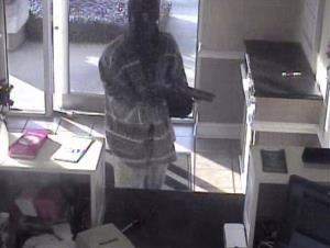 This is a BancorpSouth bank surveillance screen shot released by the Mississippi Department of Public Safety of the robbery.