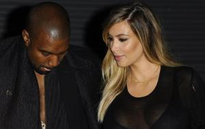 In this Sept. 29, 2013 file photo, Kanye West and Kim Kardashian arrive at Givenchy's ready-to-wear Spring/Summer 2014 fashion collection in Paris.