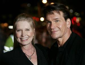In this Nov. 28, 2005 file photo, actress Patrick Swayze, right, is accompanied by his wife Lisa Niemi prior to the premiere of his film Keeping Mum in central London.