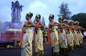 Balinese girls in traditional costumes dance during a parade for this year's last sundown in Bali island, Indonesia on New Year's Eve, Tuesday, Dec. 31, 2013.