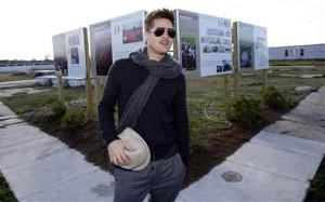 Brad Pitt poses for a photograph in the Lower 9th Ward as he visits the area where homes are being built for the Make It Right Foundation in New Orleans, Monday, Dec. 1, 2008.