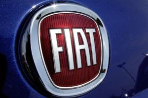 This July 8, 2012 file photo shows Chrysler's Fiat logo at an auto dealership in Springfield, Ill.