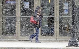 A pedestrian walks along Norh Main Street, Wilkes-Barre, Pa., during a snowstorm, Tuesday, Dec. 31, 2013.