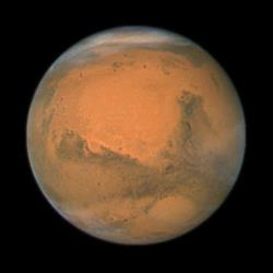 In this file image provided by NASA's Hubble Space Telescope a close-up of the red planet Mars is shown.