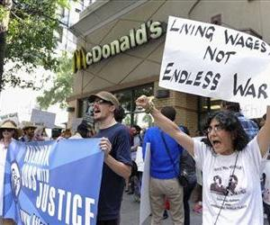 Protesters call for higher wages for fast food industry workers during a one day strike coinciding with strikes at other fast food restaurants across the country, Aug. 29, 2013, in Atlanta.
