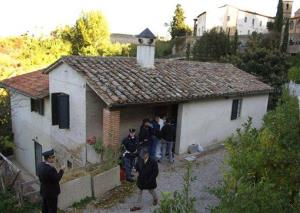 In this Nov. 7, 2007, file photo, police officers inspect the house where British student Meredith Kercher was killed in Perugia, Italy.