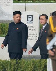 In this July 25, 2013, photo, North Korean leader Kim Jong Un, left, and his uncle Jang Song Thaek walk through a cemetery for Korean War veterans in Pyongyang.