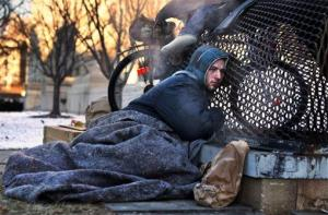 An Associated Press photographer looking for a way to illustrate unusually cold weather took a picture of Simmons as he warmed himself on a steam grate a few blocks from the US Capitol.