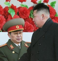 In this Feb. 16, 2012 file photo, North Korean leader Kim Jong Un walks past his uncle Jang Song Thaek, left.