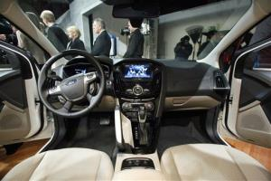 The Ford Electric Focus car's interior, featuring MyFord Touch interface, is shown.