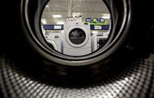 In this Tuesday, June 19, 2012 photo, washing machines sit on display on a showroom floor at a Lowe's store in Atlanta.