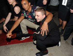 Madonna's son Rocco Ritchie, right, attends the world premiere of Madonna: The MDNA Tour hosted by The Cinema Society and Dolce & Gabbana at the Paris Theatre on Tuesday, June 18, 2013 in New York.