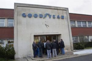 Workers of the Goodyear tire factory gather at an entrance to the plant in Amiens, northern France yesterday.