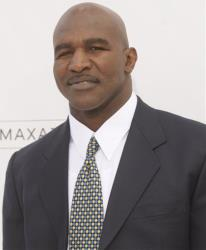 In this May 22, 2011 file photo, Evander Holyfield arrives at the 2011 Billboard Music Awards, in Las Vegas.