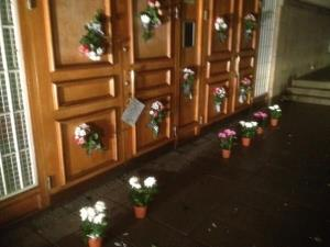 A photo of the flowers pasted over swastikas on the doors of a Swedish mosque.
