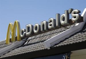 A McDonald's sign is shown at a McDonald's restaurant in East Palo Alto, Calif.
