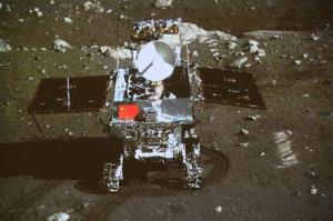 In this image taken by the on-board camera of the lunar probe Chang'e-3, China's first moon rover 'Yutu' - or Jade Rabbit - is on the lunar surface.