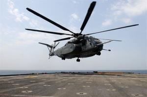 A photo provided by the US Navy shows an MH-53E Sea Dragon helicopter.