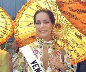 In this May 11, 2005 file photo, Miss Venezuela Monica Spear poses for photographs outside the Grand Palace ahead of the Miss Universe pageant in Bangkok, Thailand.